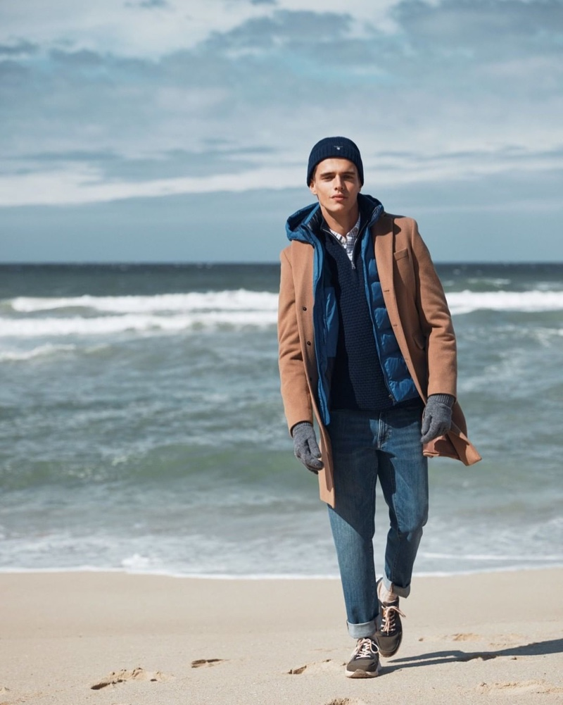 Taking to the beach, Jordy Baan appears in GANT's fall-winter 2019 campaign.