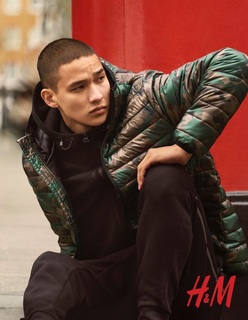 Embracing a city cool, Tommy Vanden Meerssche wears a puffer jacket by H&M.