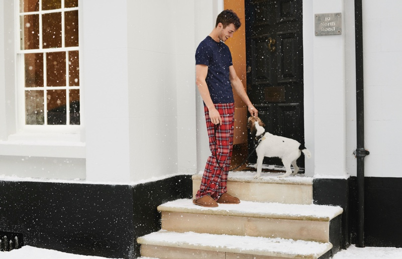 Sporting pajama pants, Kit Butler reunites with H&M for the holidays.