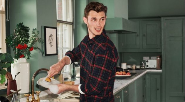Doing the dishes, Kit Butler sports a H&M regular fit flannel shirt.