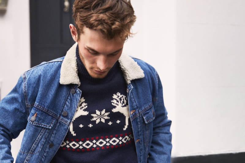 British model Kit Butler wears a jacquard-knit turtleneck sweater with a denim jacket from H&M.