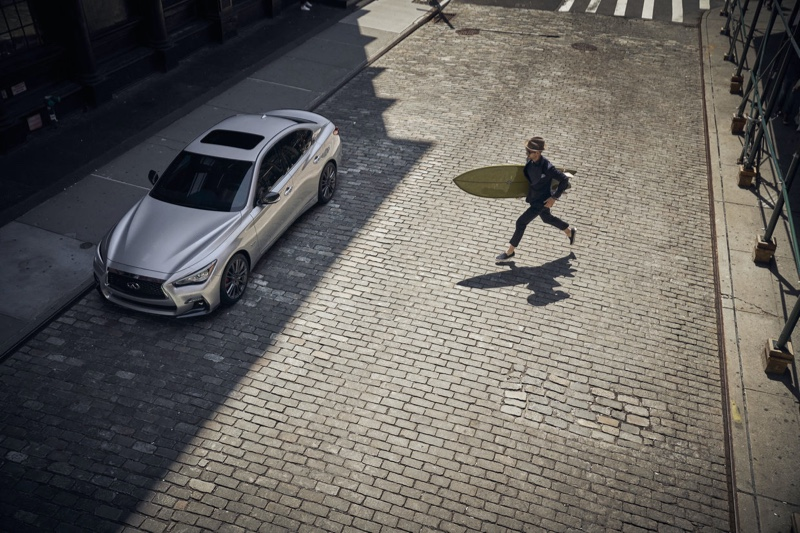 Taking a surfboard in hand, Max Jablonsky fronts Infiniti's campaign.