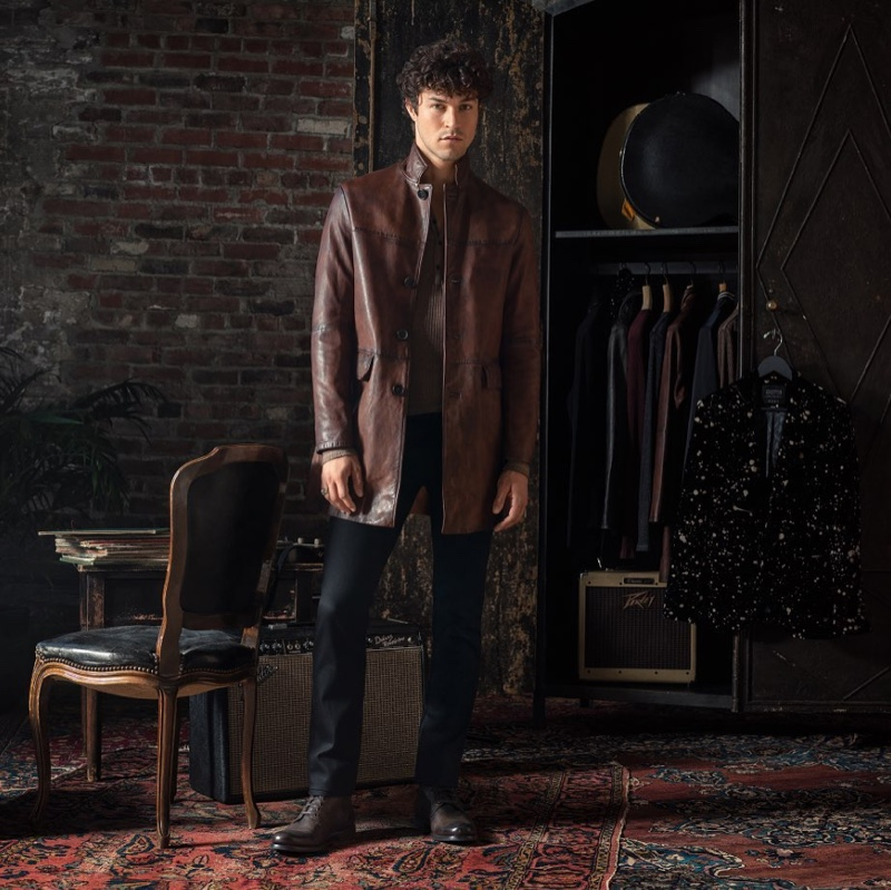 Model Miles McMillan dons a brown leather coat $2,698 from the John Varvatos x Led Zeppelin capsule collection.