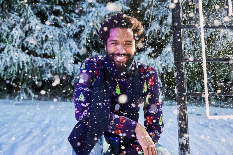 Thiago Santos wears a festive look for Jules' Christmas 2019 campaign.