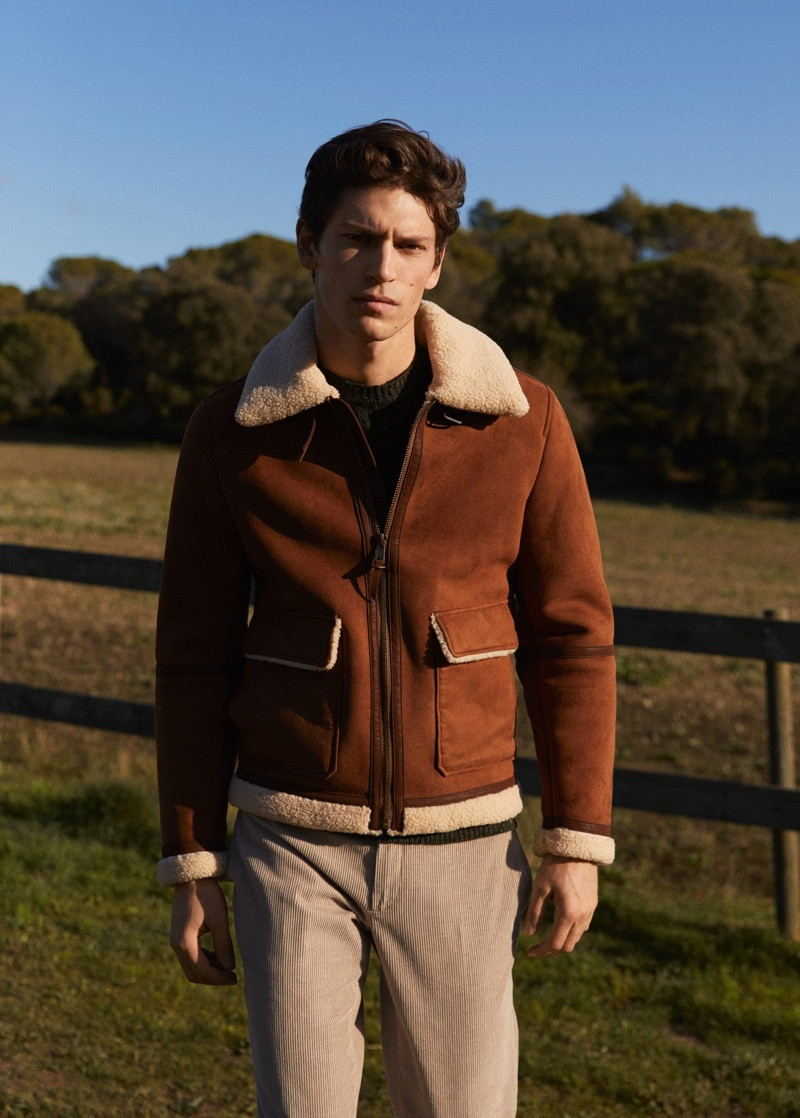 Model Justin Eric Martin rocks a brown faux suede jacket from Mango with corduroy pants.