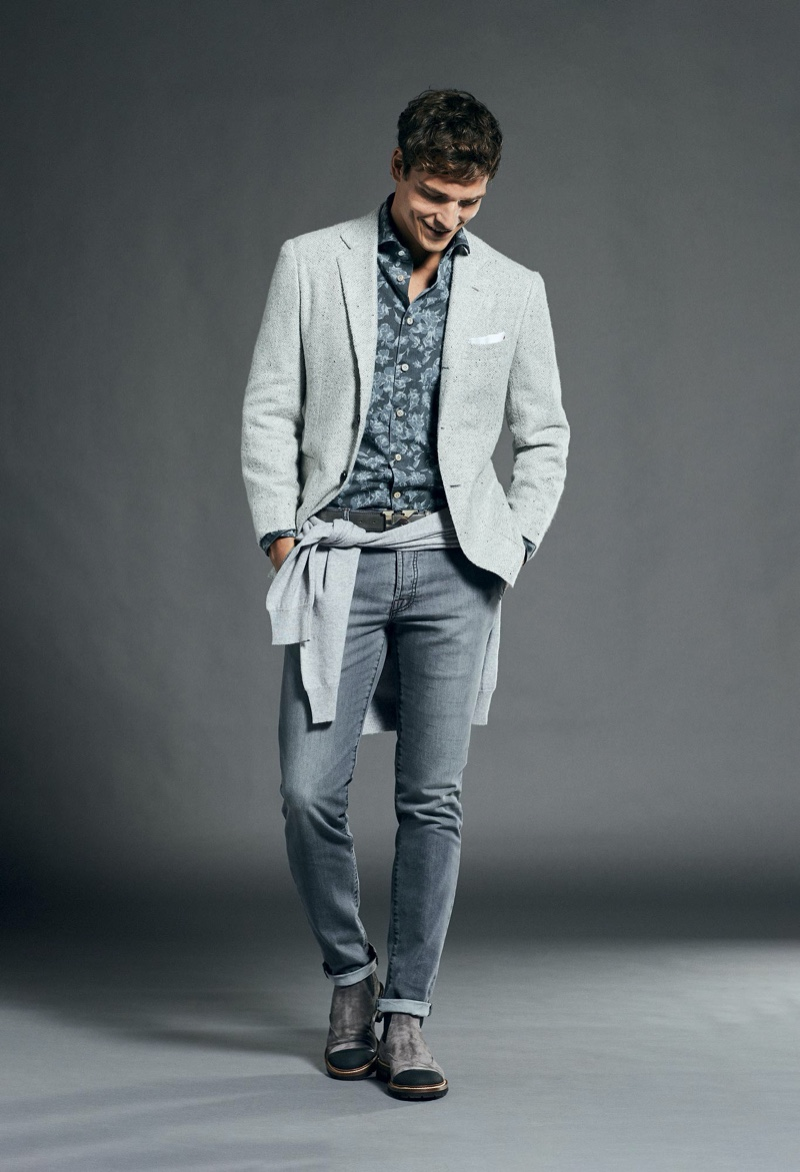 Taking to the studio, Alexandre Cunha dons a chic gray ensemble from Kiton.