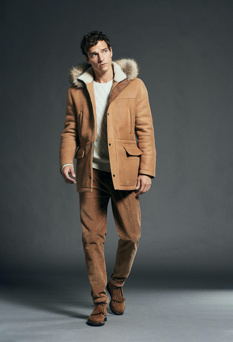 Making a case for rich brown hues, Alexandre Cunha dons a shearling coat and corduroy pants from Kiton.
