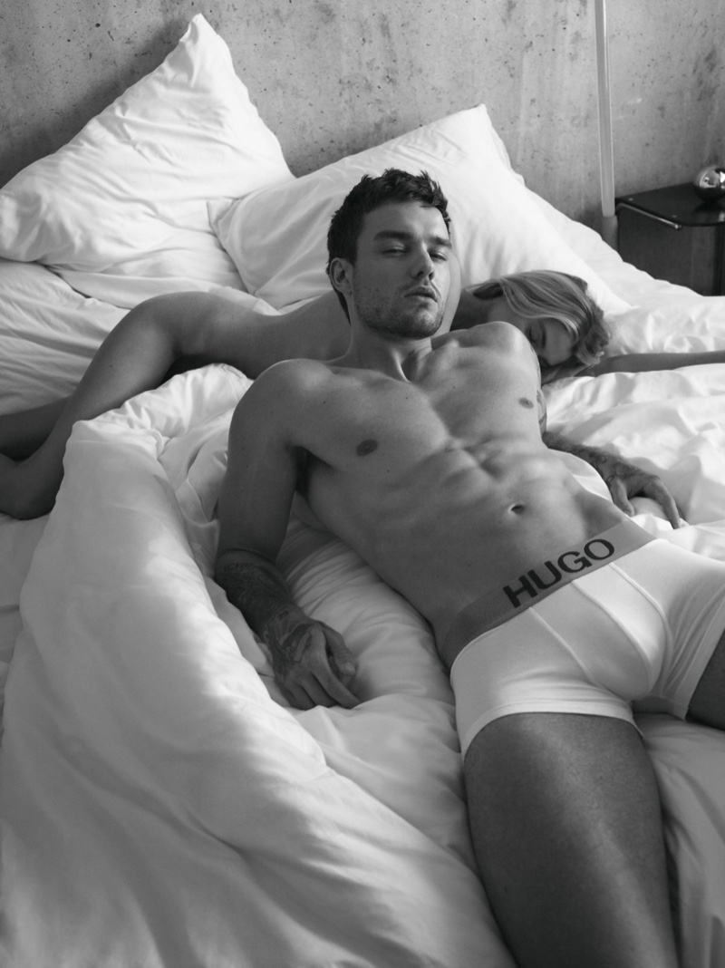 Laying in bed, Liam Payne appears in HUGO's Bodywear campaign.