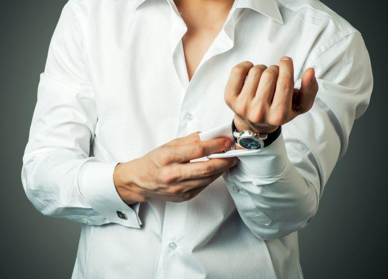 Man Adjusting Watch