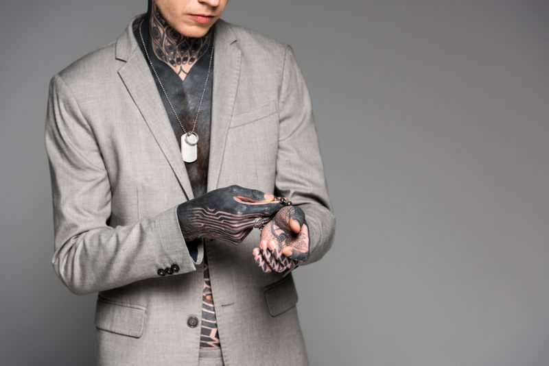 Man with Tattoos Wearing Jewelry
