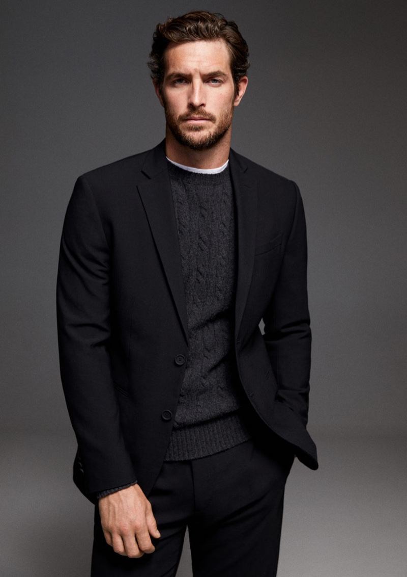 Making a case for black and gray, Justice Joslin wears a Mango suit with a cable-knit sweater.