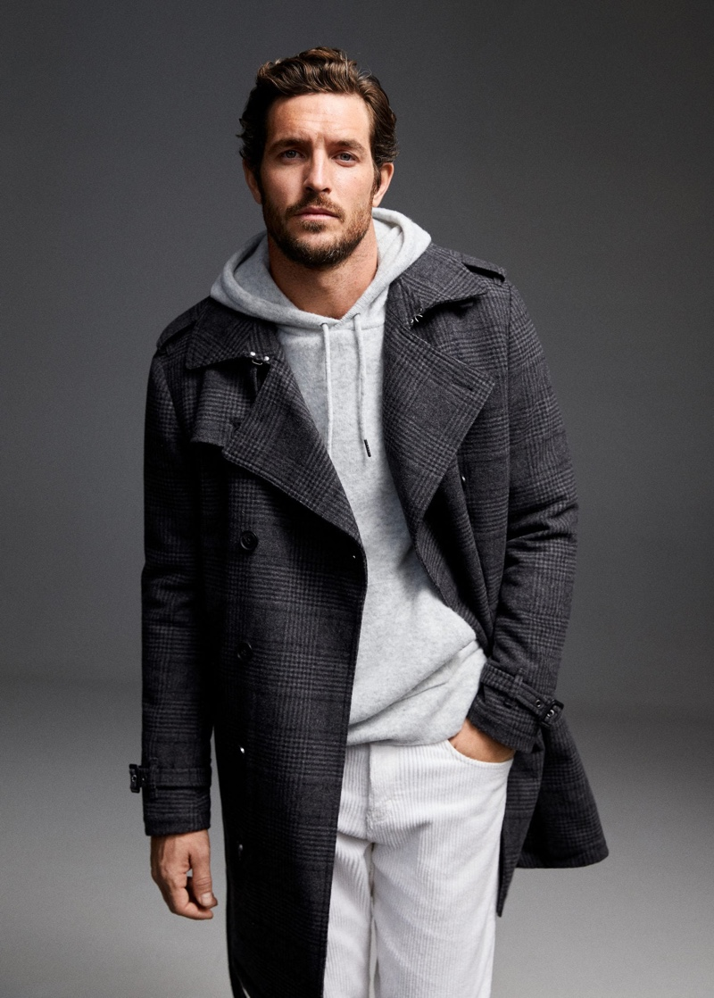 Going for a casual chic look, Justice Joslin dons an overcoat with a hoodie and corduroy pants by Mango.