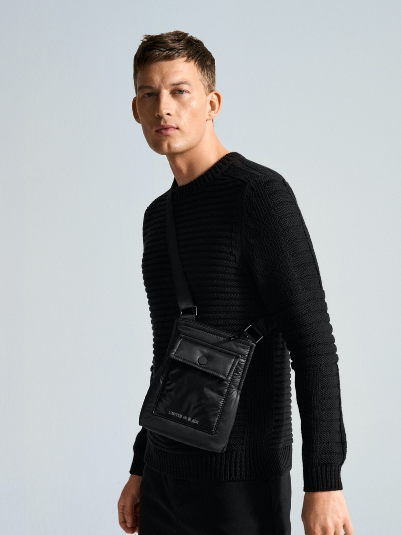 Front and center, Bastian Thiery models a ribbed sweater and bag from Marc O'Polo.