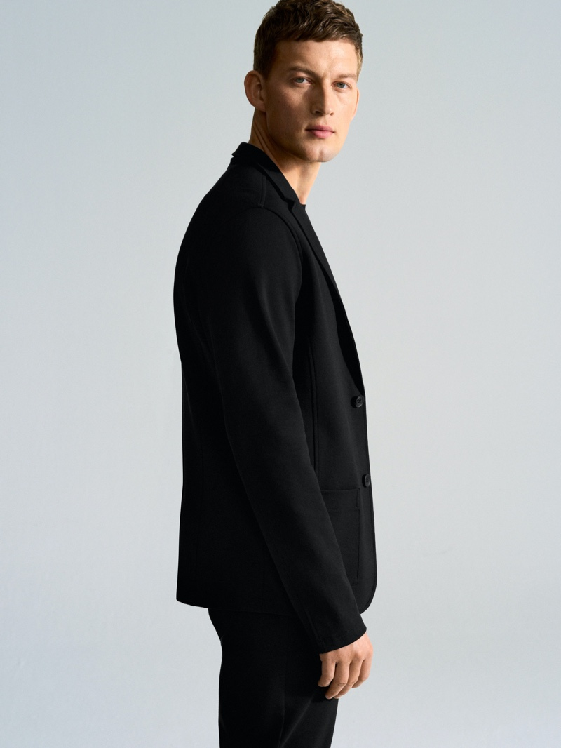 A sleek vision, Bastian Thiery dons a suit jacket by Marc O'Polo.