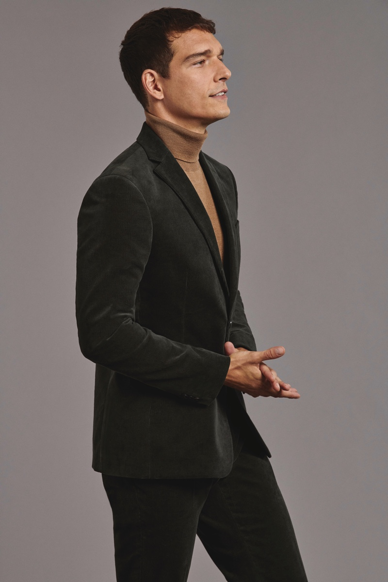 A chic vision, Alexandre Cunha sports a velvet suit with a turtleneck sweater from Marks & Spencer.