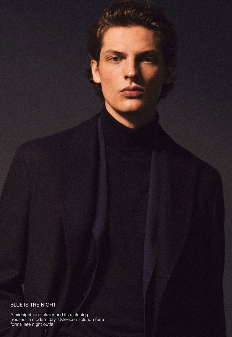 Embracing midnight blue, Valentin Caron dons a sartorial look by Massimo Dutti.