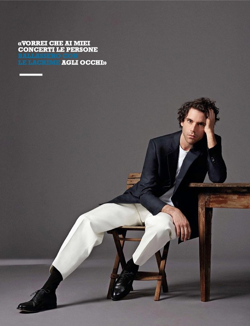 A chic vision, Mika sports a shirt and jacket by Giorgio Armani with Emporio Armani pants.