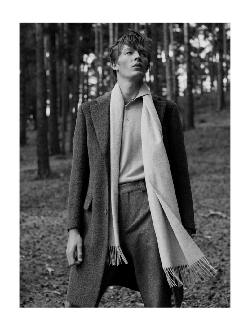 Front and center, Finnlay Davis dons a llama hair and virgin wool-blend coat from Brioni.