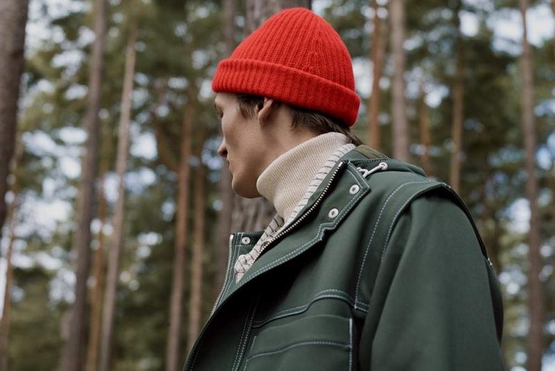 Venturing outdoors, Finnlay Davis sports a Jacquemus canvas hooded jacket.