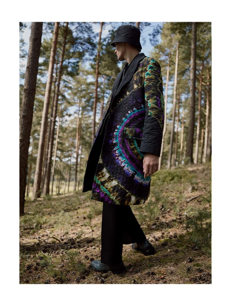 Stepping out in a tie-dye print, Finnlay Davis models a must-have oversized quilted coat from Dries Van Noten.