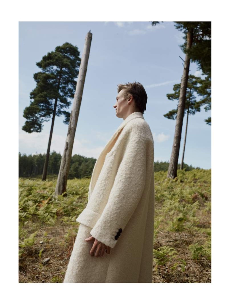A sleek vision, Finnlay Davis dons an AMI oversized soft wool overcoat in white.