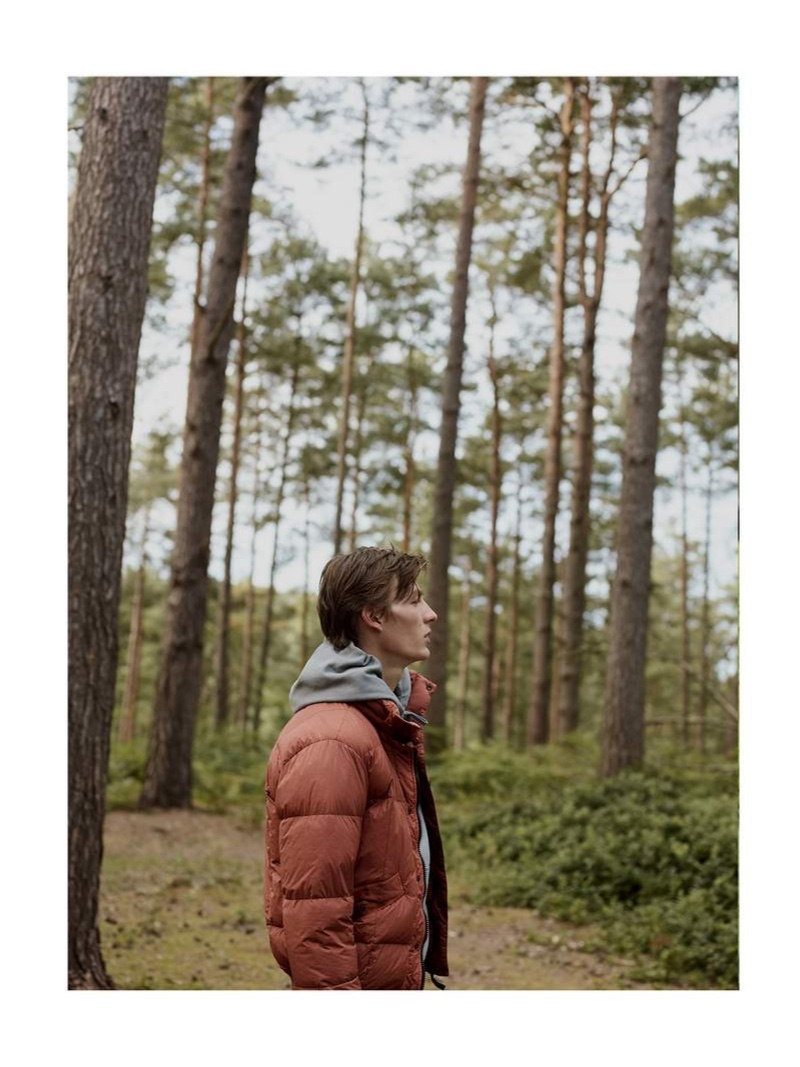 Taking to the woods, Finnlay Davis sports a Stone Island garment-dyed quilted crinkle nylon down jacket.