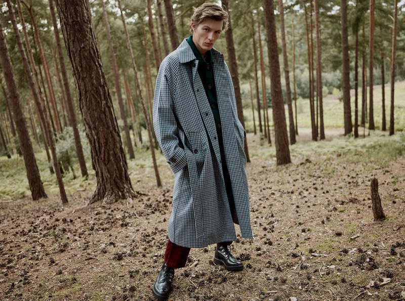 Finnlay Davis dons an oversized belted gingham wool-blend coat by Acne Studios.
