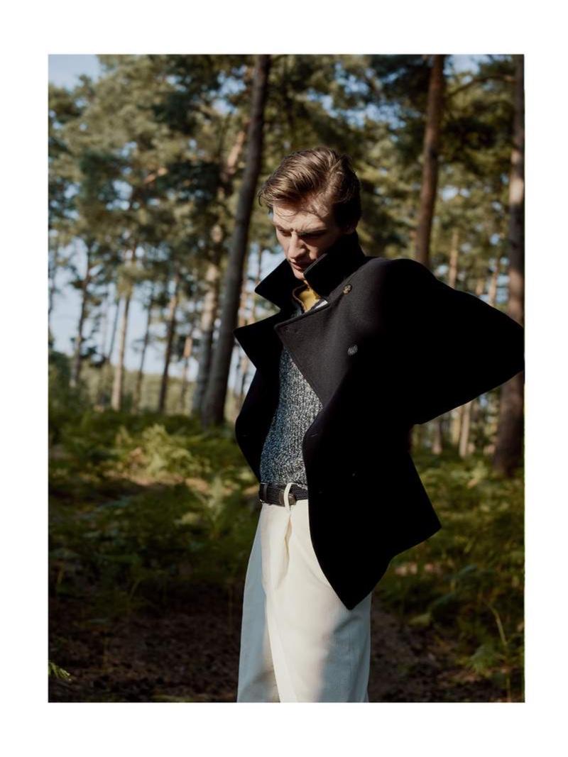 Donning a sleek peacoat, Finnlay Davis wears a style from Loro Piana.