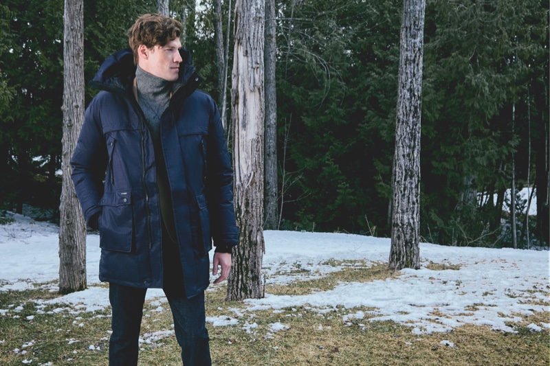 Stepping outdoors, Alex Loomans sports a blue jacket from Nobis' fall-winter 2019 collection.