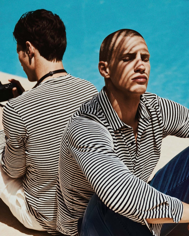 Augusta Alexander wears Orlebar Brown's Sebastian linen navy/white striped tailored long-sleeve polo $295.