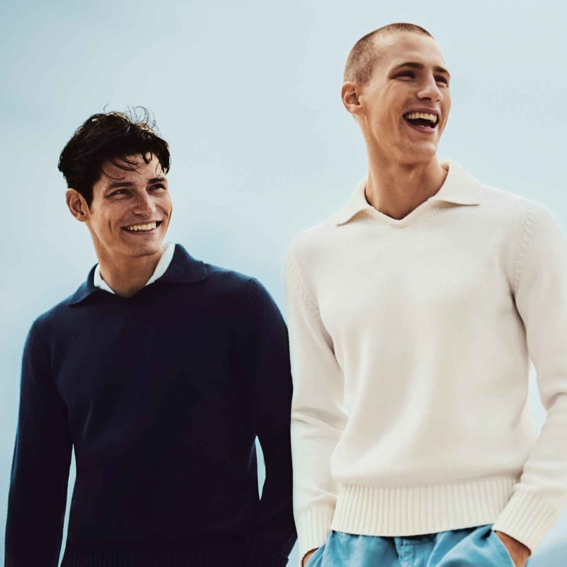 Models Sam Way and Augusta Alexander sport Orlebar Brown's Hedley canvas classic fit knitted sweatshirt $525 in navy and canvas.