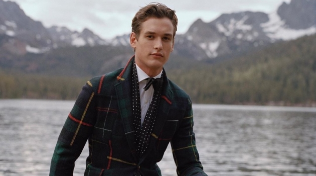 Jegor Venned dons a tartan blazer with velvet pants from POLO Ralph Lauren.