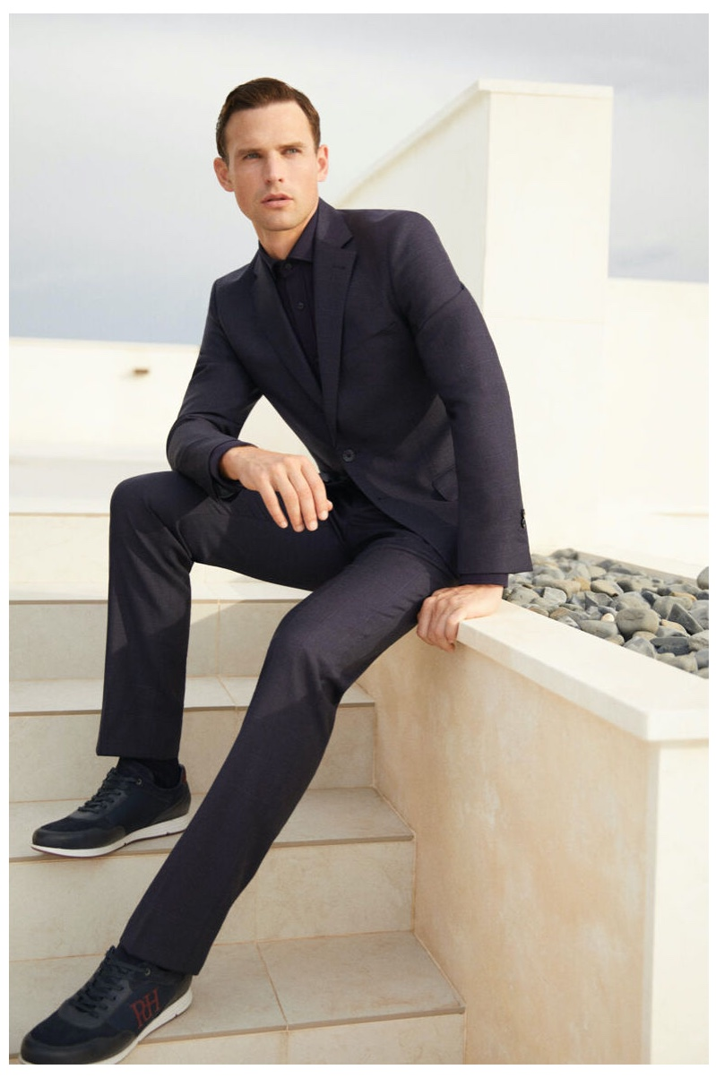 Ready for a date, Guy Robinson embraces monochromatic dressing in a tailored look from Pedro del Hierro.