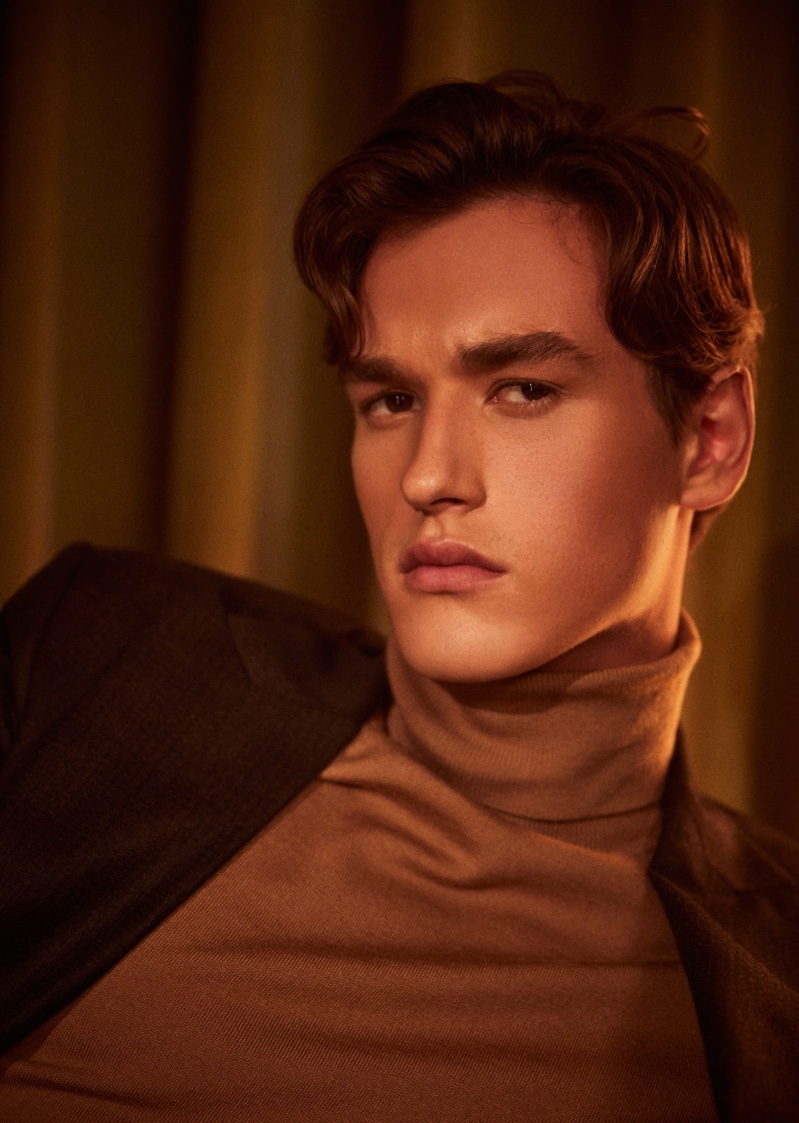 Donning a turtleneck and suit jacket, Jegor Venned connects with Reiss to showcase its partywear.