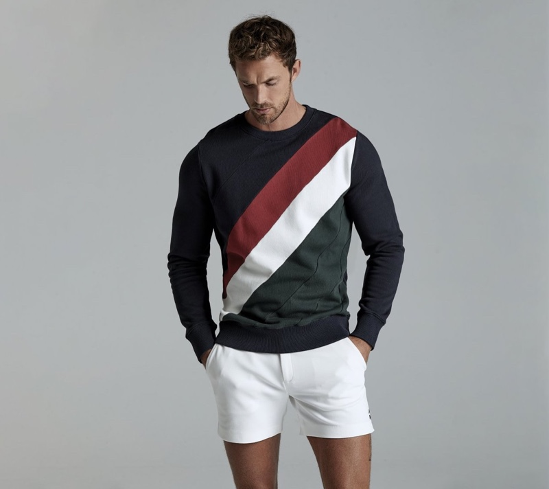 Front and center, Christian Hogue sports a colorblock sweatshirt and shorts from Ron Dorff.
