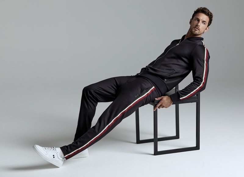 A sporty vision, Christian Hogue models a tracksuit by Ron Dorff.