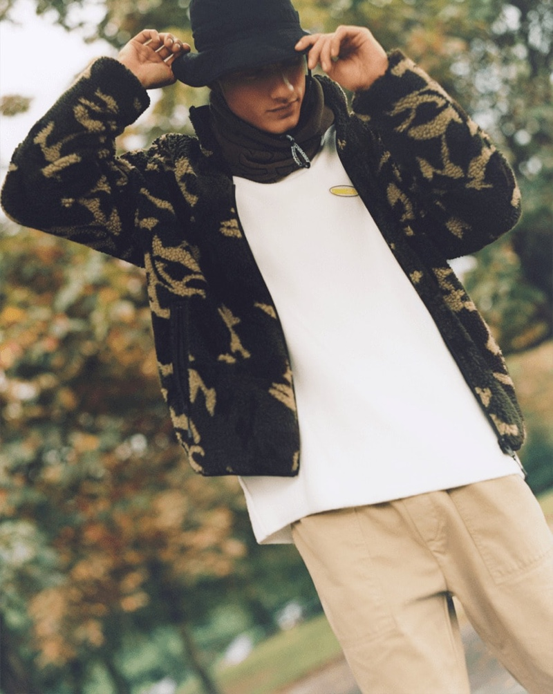 Sporting streetwear-inspired fashions, Serge Rigvava wears Bershka.