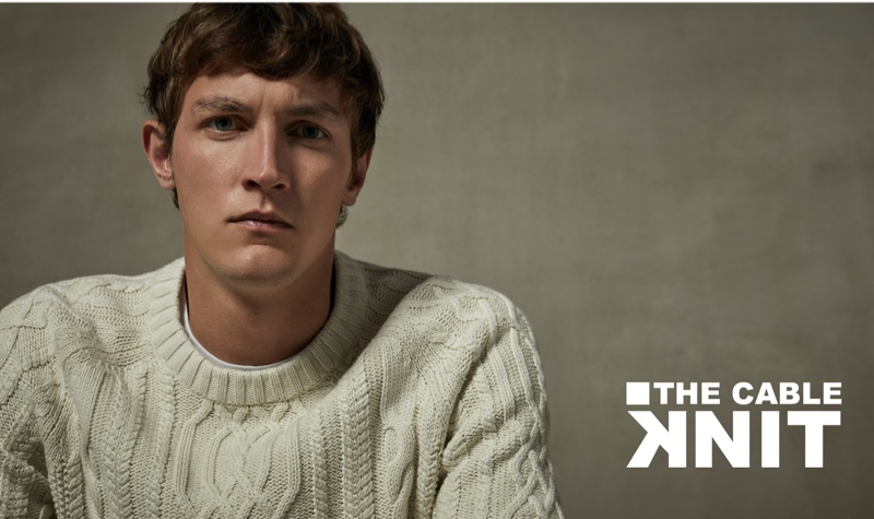 Connecting with Sfera, Rutger Schoone wears an off-white cable-knit sweater.