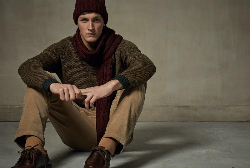 Taking to the studio, Rutger Schoone wears a fall-winter 2019 look from Sfera.