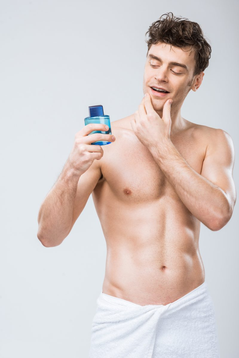 Shirtless Male Model Bottle of Cologne