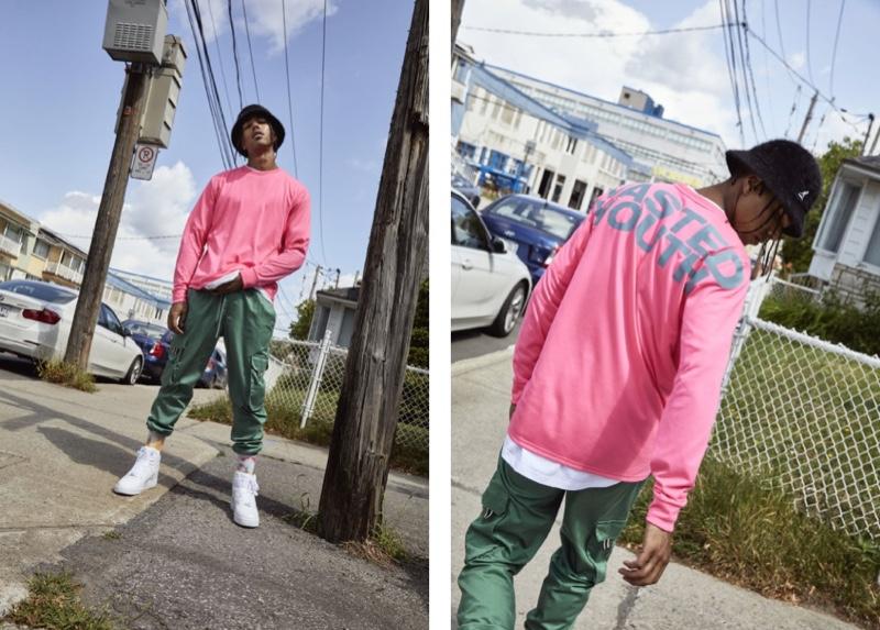 Sadjo Ka sports a long-sleeve pink shirt and green cargo pants from Djab.