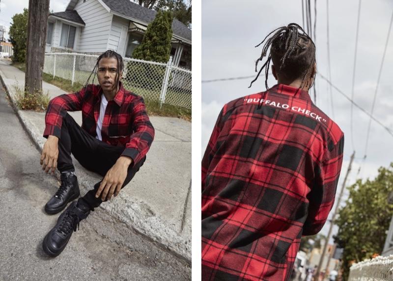 Front and center, model Sadjo Ka rocks a red and black buffalo check shirt from Djab.