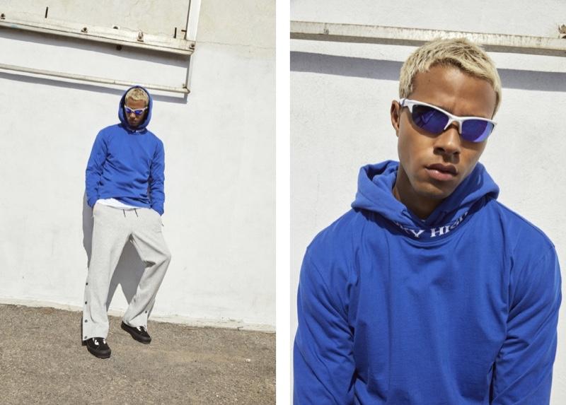 Sporting a blue hoodie with Djab pants, Daouda Ka is a cool vision.