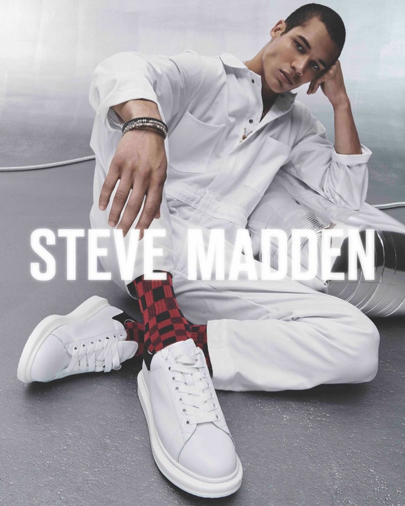 Clad in white, T.J. Moore fronts Steve Madden's holiday 2019 campaign.
