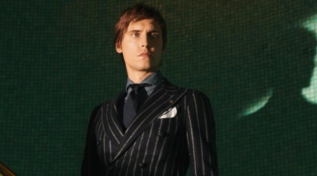 Sébastien Andrieu dons a pinstripe suit for Tagliatore's fall-winter 2019 campaign.