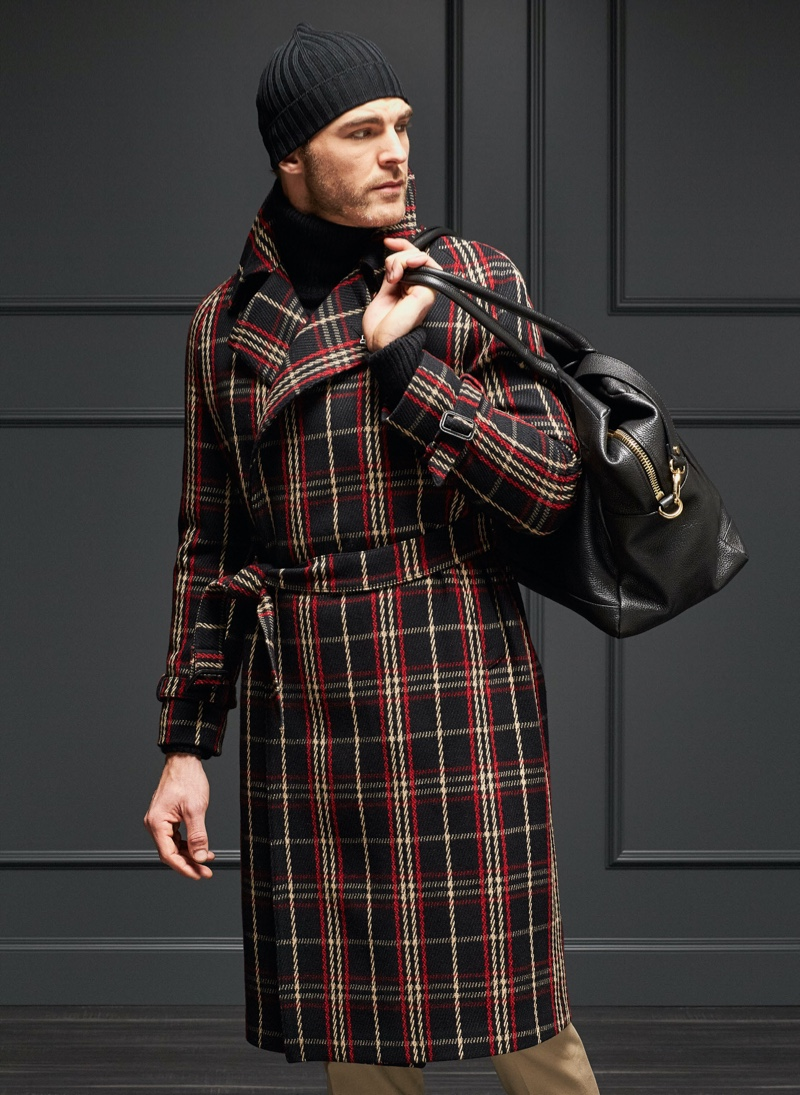 Making a checked statement, Patrick Kafka sports a coat from Tagliatore.