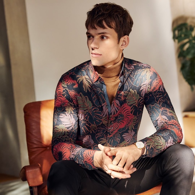 Embracing a graphic motif, Adrian Sotiris wears Ted Baker's tiger print shirt $165.