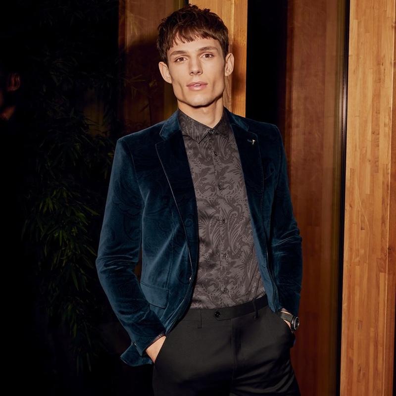Adrian Sotiris dons a regal Ted Baker velvet jacket $785 in dark blue.