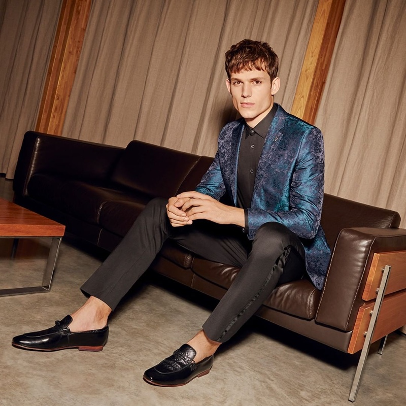 Connecting with Ted Baker, Adrian Sotiris sports the brand's teal jacquard blazer $785.