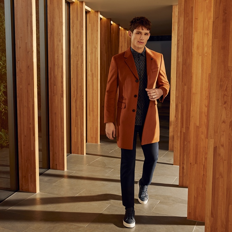 Front and center, Adrian Sotiris models Ted Baker's cashmere blend Mariano overcoat $749 in camel.